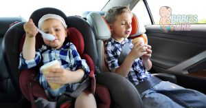 Kids eating ice cream in the back seat - a messy business